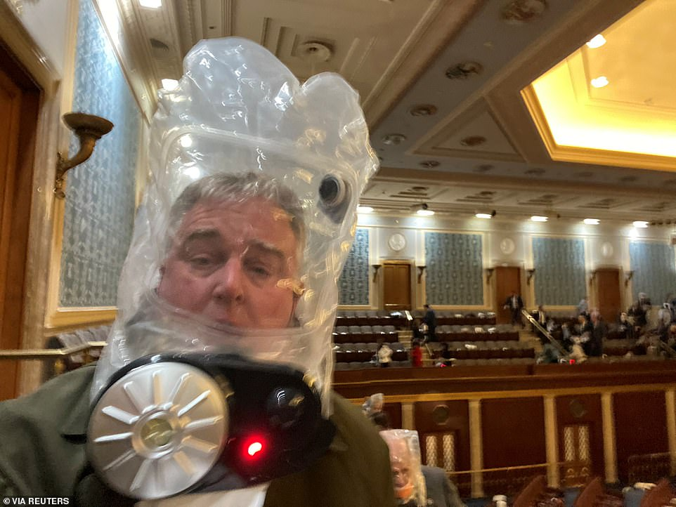 Rep. David Trone wears a gas mask inside the US Capitol. Lawmakers cowering inside the House Chamber were urged to put on gas masks as tear gas was fired in the Rotunda