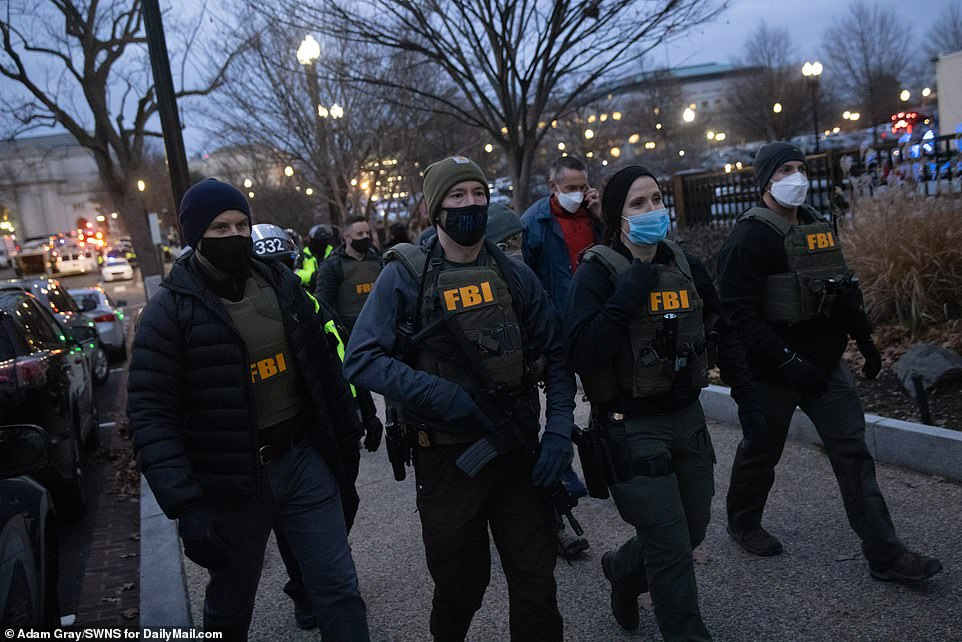 FBI agents arrive on the Capitol grounds to help enforce a 6pm curfew